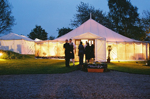 Traditional marquees fit well against older buildings in Scotland